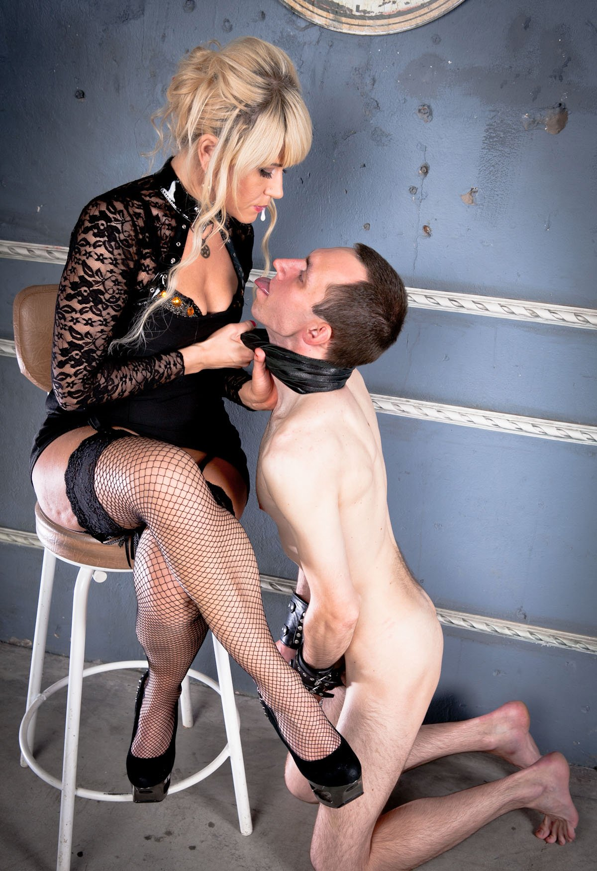 Foot slave teased by two dominant girls